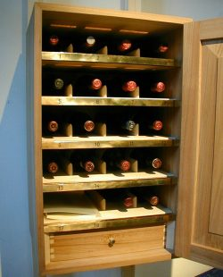 Partnership-cabinet-for-storing-bottles-as-open-by-Lampsbykeldebeak